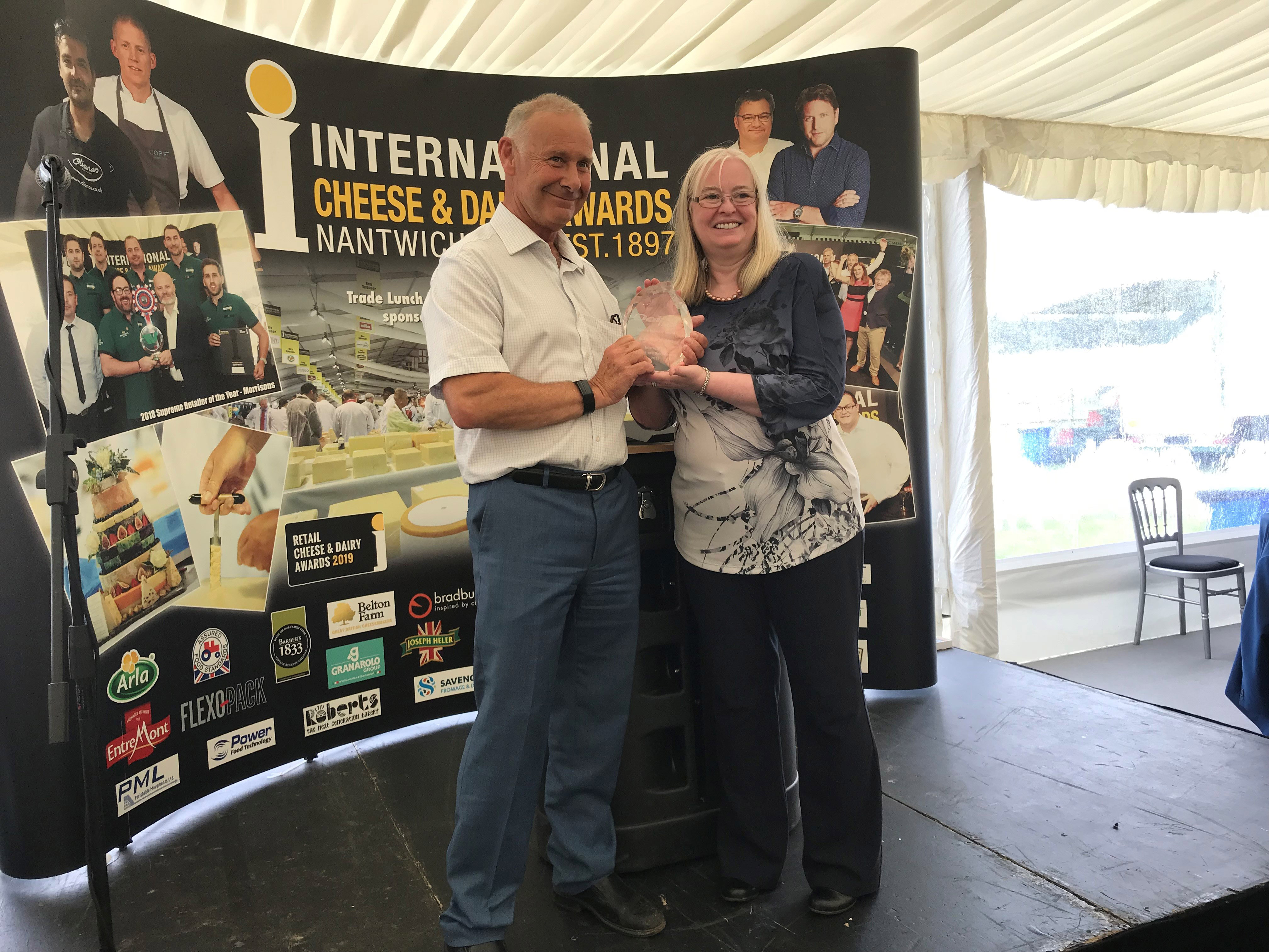 Alan Armstrong receives cheese award from Judith Bryans